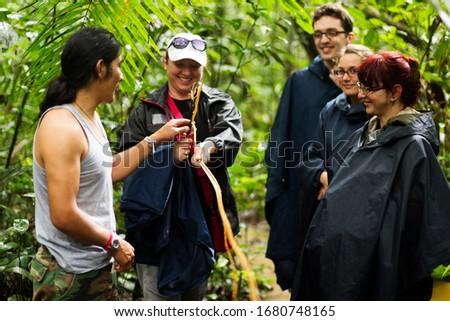 naturalist local lead with crowd of tourist in cuyabeno wild animal preserve ecuador journey path run drive amazon trekker plant team holiday indigens vegetation nature land expedition waterway femini #1680748165