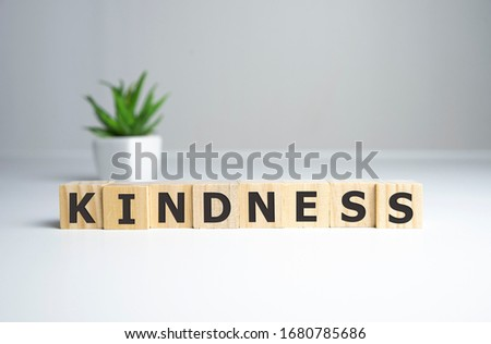 KINDNESS - words from wooden blocks with letters, KINDNESS concept, top view background. Royalty-Free Stock Photo #1680785686