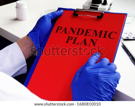 Doctor is reading pandemic plan for preparedness. #1680810010