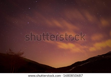 astral starry night sky with valley silhouette  Royalty-Free Stock Photo #1680850687