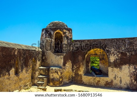 Corner bastion. Loopholes in the thick ancient walls. Fort Jesus -  medieval fortification in Mombasa, Kenya. UNESCO listed Fort as World Heritage Site. The concept of historical, and photo tourism