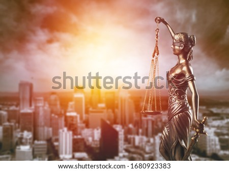 Bronze lady with scale, symbol of justice and law on city background #1680923383