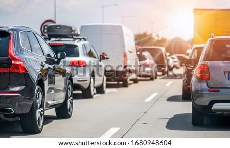 Cars rush hours city street. Car on highway in traffic jam on road. Royalty-Free Stock Photo #1680948604