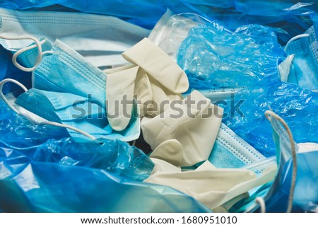 Medical trash. Coronavirus protection equipment in medical waste bin. Used face masks and sterile gloves. Doctor uniform for patient treatment in hospital. Prevention the spread of COVID-19. #1680951010