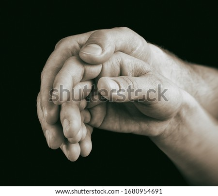 Hands of man and woman are connection to each other. On black background. Image. Concept of love, care, friendship. #1680954691