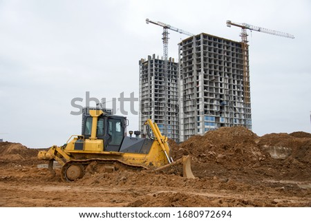Track-type dozer for pool excavation and utility trenching. Bulldozer during land clearing and foundation digging. Earth-moving heavy equipment at construction site. Digger for road construction #1680972694