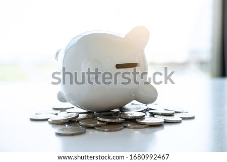 Image of piggy bank and stacking pile coins to planning growing saving strategy for future plan fund of wealth, travel, education, investment and retirement. #1680992467