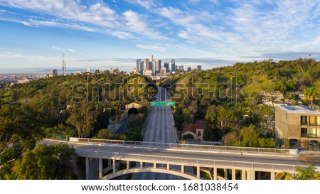 Aerial view of empty freeway streets with no people in downtown Los Angeles California as result of  coronavirus pandemic or COVID-19 virus outbreak and lockdown. Royalty-Free Stock Photo #1681038454
