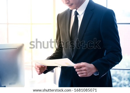 Businessman with graph paper at office workplace. Business management concept. #1681085071