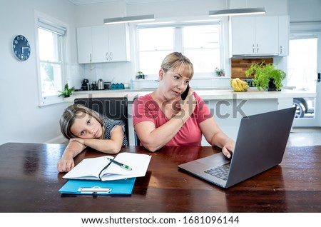 Coronavirus Outbreak schools and offices closing. Stressed mother coping with remote work and bored daughter. COVID-19 shutdowns and quarantines forces parents to work from home and homeschooling. #1681096144