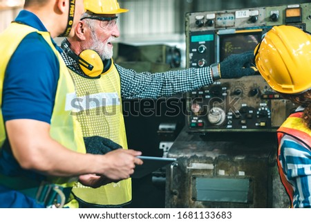 Industrial Engineers in Hard Hats.Work at the Heavy Industry Manufacturing Factory.industrial worker indoors in factory.aged man working in an industrial factory. #1681133683