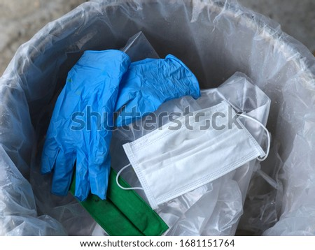 Used infectious masks and medical glove in the trash bin,infectious waste, prevented virus covid-19 by separating infected waste. Royalty-Free Stock Photo #1681151764