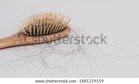 Hair loss, Solutions for hair loss,Hair loss on comb,on white background. #1681219159