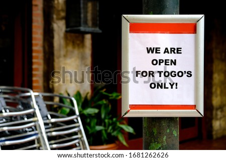 "Sign outside restaurant during corona virus outbreak "" We are open for to go's only"". In an attempt to stop the spread of covid-19 dining areas of restaurants are temporarily closed"