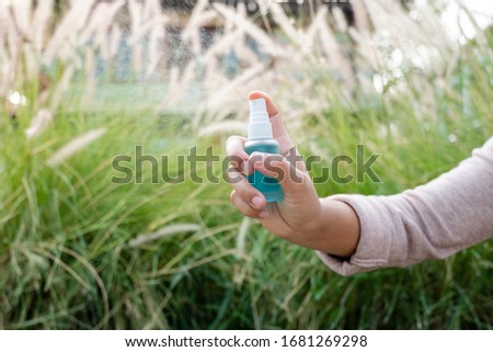 Women hand use alcohol spray to prevent the spread of germs, bacteria and viruses. Measures to prevent coronavirus infection. #1681269298