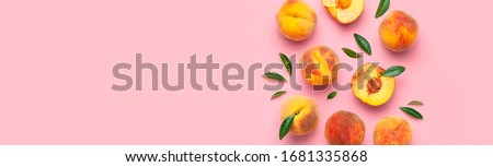 Summer fruit background. Flat lay composition with peaches. Ripe juicy peaches with green leaves on pink background. Flat lay top view copy space. Fresh organic fruit vegan food. Harvest concept Royalty-Free Stock Photo #1681335868