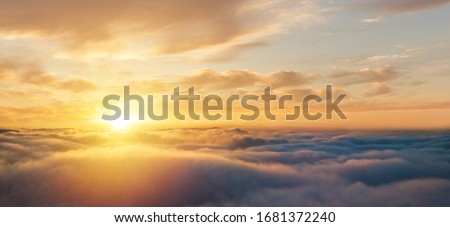 Beautiful sunset cloudy sky from aerial view. Airplane view above clouds #1681372240