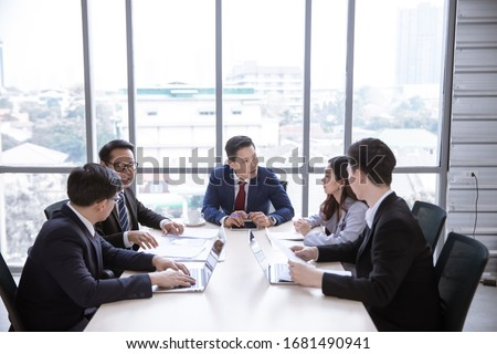 Positive Asian business team having meeting in office #1681490941