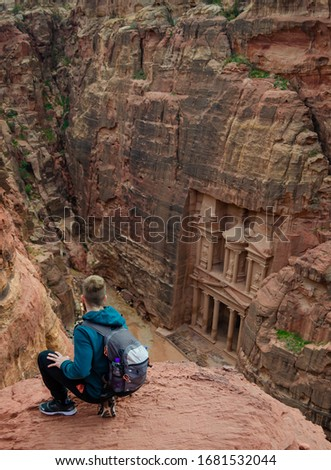 Treasure of petra from the top. Portrait of a adventurer young man  #1681532044