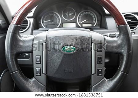 Novosibirsk, Russia – March  19, 2020:  Land Rover Discovery 3, car Interior - dashboard, player, steering wheel with logo and buttons, speedometer and tachometer