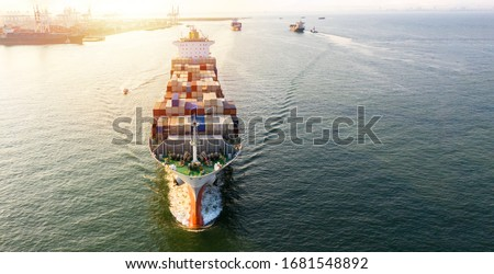 Container cargo ship  global business commercial trade logistic and transportation oversea worldwide by container cargo vessel, Container cargo freight shipping import export company. Royalty-Free Stock Photo #1681548892