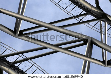 Polygonal collage photo of bridge. Abstract modern architecture. Steel girders over sky background. Metal load-bearing structure. Framework of stiffening ribs. Engineering in construction industry. #1681569940