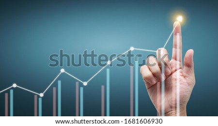 Hand touching a graphs of financial indicator and accounting market economy analysis chart #1681606930