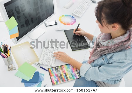 High angle view of an artist drawing something on graphic tablet at the office Royalty-Free Stock Photo #168161747