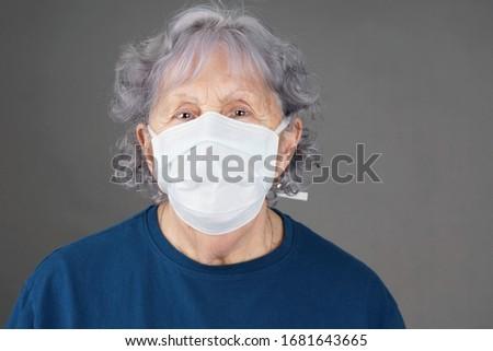 Senior woman wearing medical mask COVID-19 coronavirus pandemic concept #1681643665