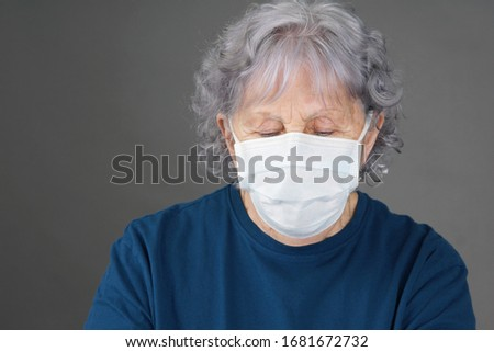 Depressed senior woman with medical mask, COVID-19 coronavirus pandemic concept #1681672732