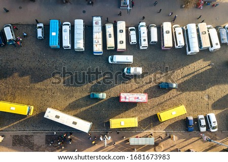 Aerial view of many cars and buses moving on a busy city street. #1681673983