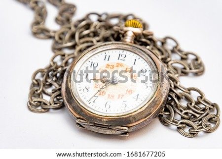Close up of old wind up pocket watch worn with silver chain made in switzerland, europe #1681677205