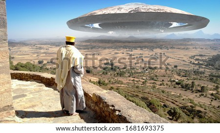Afriacn Priest Lookin at Large Alien Ufo saucer Ship over the mountains Large ufo saucer flying over mountains in Africa with priest watching  #1681693375
