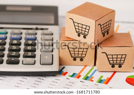 Shopping cart logo on box on chart graph paper. Banking Account, Investment Analytic research data economy, trading, Business import export online company concept. #1681711780