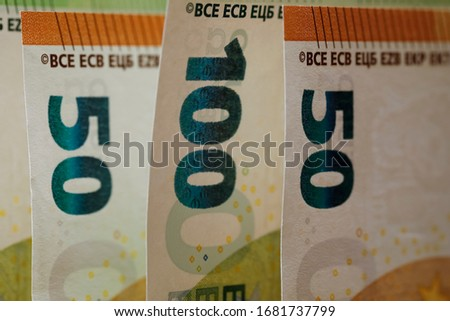 Euro money of various denominations. The currency of the euro area have been in circulation since 2002 and Euro banknotes are not made of paper, but of pure cotton fiber to improve their durability. #1681737799