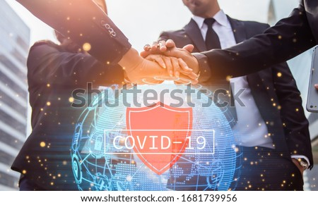 Volunteer charity work join hand together for protect covid-19 concept.Business friend colleagues hand join together and a world map in the foreground. #1681739956