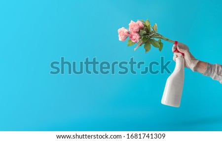 Creative desinfection idea. New Corona virus , COVID-19, or 2019-ncov infection (novel corona virus disease) inspiration. Nature or spring Pandemic protection concept with flowers. Royalty-Free Stock Photo #1681741309
