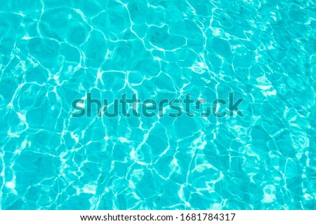 Abstract beautiful ripple wave and clear turquoise water surface in swimming pool, Turquoise or blue water wave for background and abstract Royalty-Free Stock Photo #1681784317