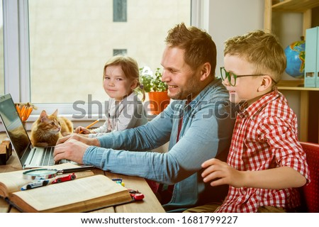 Watch movie on laptop together with children. Father and kids on quarantine have funny time. #1681799227