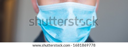 Doctor wearing a protective mask against coronavirus. men wear a mask against the virus. COVID-19. Banner panorama, medical staff, preventive equipment. hospital, laboratory, clinic. #1681869778