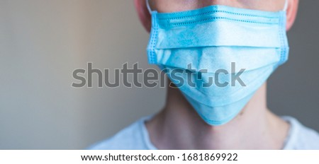 Doctor wearing a protective mask against coronavirus. men wear a mask against the virus. COVID-19. Banner panorama, medical staff, preventive equipment. hospital, laboratory, clinic. #1681869922