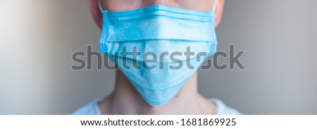 Doctor wearing a protective mask against coronavirus. men wear a mask against the virus. COVID-19. Banner panorama, medical staff, preventive equipment. hospital, laboratory, clinic. #1681869925
