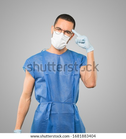 Coronavirus.Young man doing concepts and wearing mask and protective gloves #1681883404
