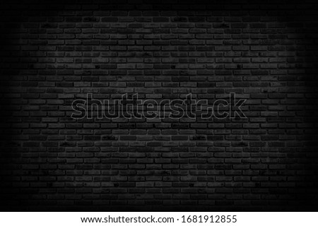 Black brick walls that are not plastered background and texture. The texture of the brick is black. Background of empty brick basement wall. #1681912855