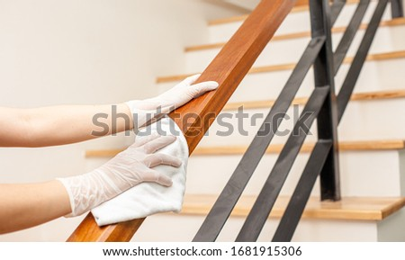 Deep cleaning for Covid-19 disease prevention. alcohol,disinfectant spray on Wipes of Banister in home for safety,infection of Covid-19 virus,contamination,germs,bacteria that are frequently touched . #1681915306