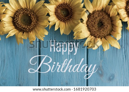 Happy Birthday. Birthday greeting card with sunflower flowers and a greeting lettering. Vintage card. Template for e-mail newsletter and congratulatory banner on the site