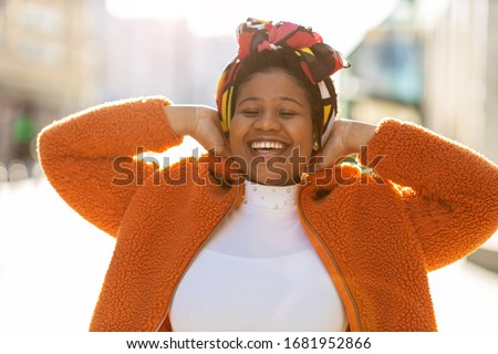 Afro american woman in an urban city area Royalty-Free Stock Photo #1681952866