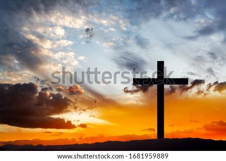 Wooden cross against sky background   , Easter background. Christian cross against celestial clouds.