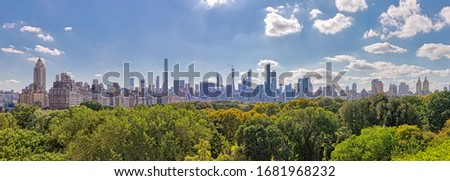 NEW YORK, USA - OCTOBER 01, 2018: View of the Central Park treetops with Midtown Manhattan panorama in the background. #1681968232