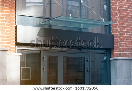 Blank black rectangular box store entrance mockup , glass and brick wall. Empty shop or storehouse banner frame mock up. Clear outdoor signplate for boutique or business company mokcup template.